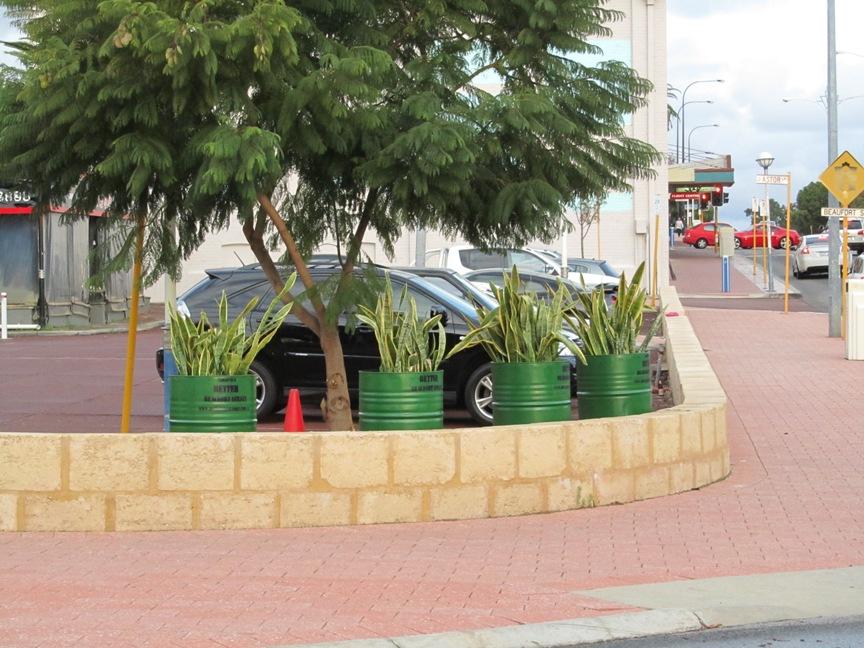 Barrel planters on corner of Field Street