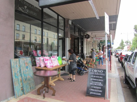 Slow the pedestrian flow past your shop by bringing wares outside to sell. It's more interesting for pedestrians and more floorspace for businesses